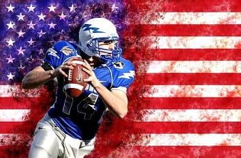 Ein NFL-Footballspieler vor einer US-Flagge.