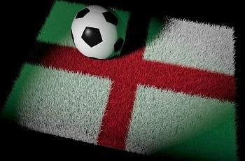 Ein Fußball auf einem Englandteppich.